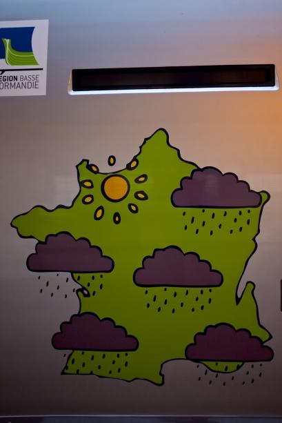 Reklam för Normandie på tågen